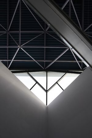 Light window under a roof of industrial building. Stock Photo