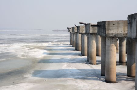 Abandoned pier. The river Volga in the early spring. Stock Photo