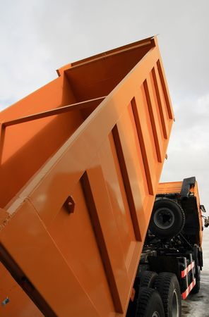 Truck with lifted dump and cabin. Isolating path is included. Standard-Bild