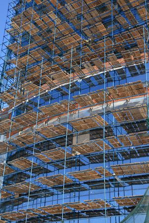 Construction staging on glass facade.