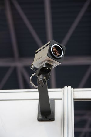 CCTV security camera on dark ceiling background. Standard-Bild