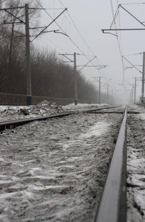 Dirty snow on railway track.