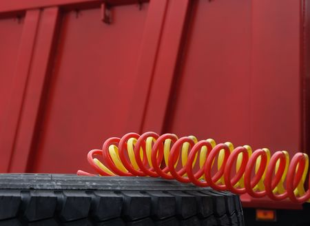 Cables the tractor-trailer in a spiral braid. Stock Photo