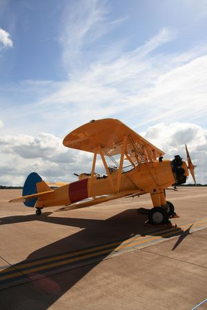 Old biplane on airfield.