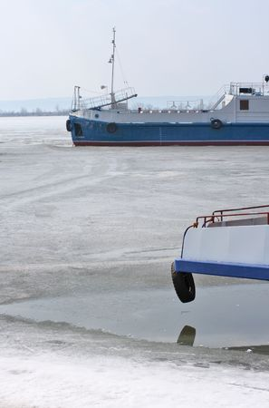 River ships at a mooring in ice.