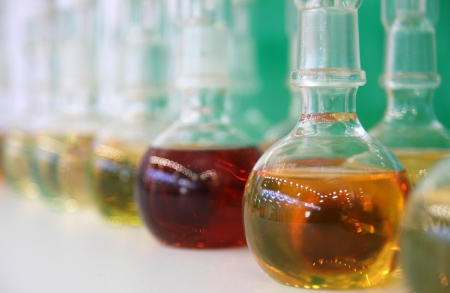 Laboratory flasks with colored oil