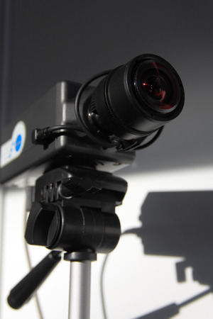 CCTV security camera on white wall background. Stock Photo
