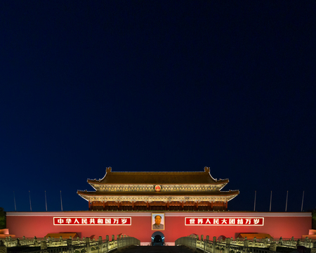 Tiananmen, or the Gate of Heavenly Peave, in Beijing, China, at Night. The placards read Editorial