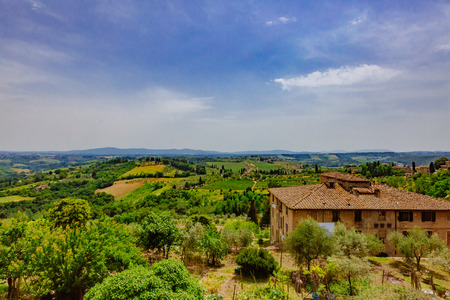 Tuscan fields and landscape near the medieval hill town of San Gimignano, Italy