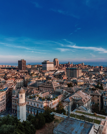 View of the historical center and downtown of Genoa, Italy at dusk Редакционное