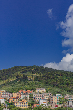 Houses on hills under blue sky in the town of Porto Venere, near Cinque Terre, Italy