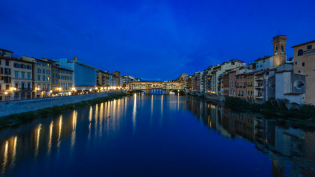 Ponte Vecchio and houses over Arno River in Florence, Italy