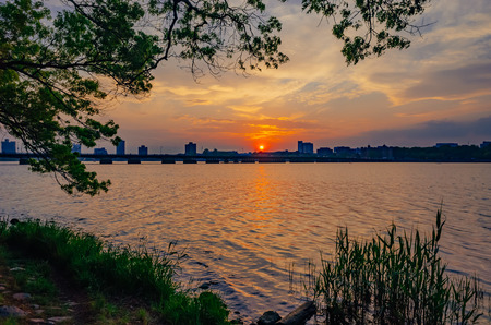 View of sunset over Charles River with skyline of Cambridge, in Boston, USA
