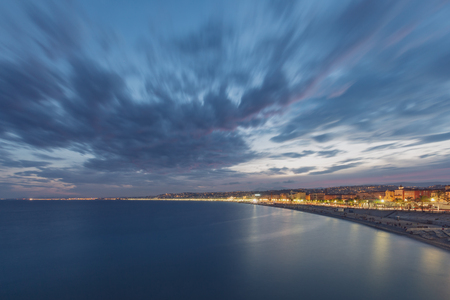 View of the city of Nice, France next to sea after sunset in early evening