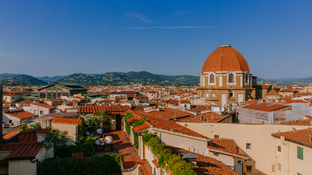 View of the dome of San Lorenzo Basilica under blue sky, over houses of the historical center of Florence, Italy Stock Photo