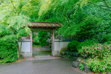 View of wooden gate among trees at Portland Japanese Garden, Portland, USA