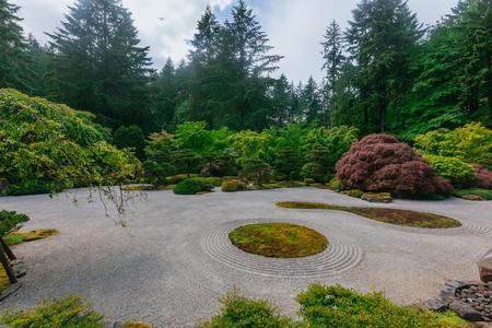 View of sand garden among trees at Portland Japanese Garden, Portland, USA Stock Photo