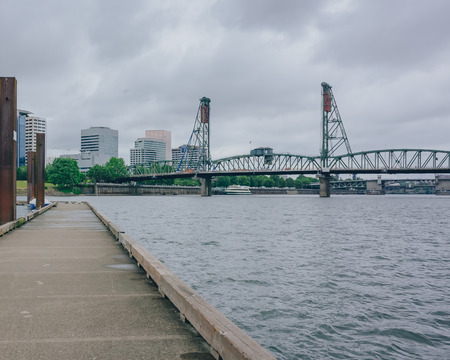 View of Hawthorne Bridge over Willamette River in downtown Portland, USA