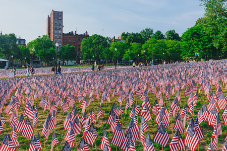 Boston, USA - May 27, 2016: View of thousands of US flags planted in Boston Common, to commemorate fallen soldiers in wars, during Memorial Day weekend