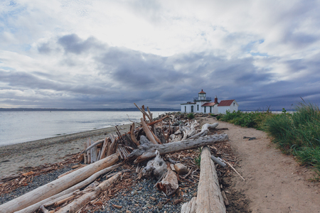 Path leading to the Victorian-era lighthouse in Discovery Park of Seattle, USA Stock Photo
