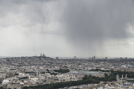 Panoramic view of the city of Paris, France from top of Eiffel Tower on a cloudy day