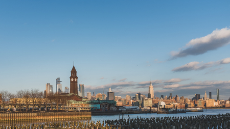 Hoboken train station in New Jersey with skyline of midtown Manhattan Фото со стока