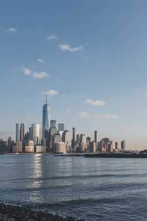 Skyline of downtown  Manhattan of New York City at dusk, over Hudson River, viewed from New Jersey, USA
