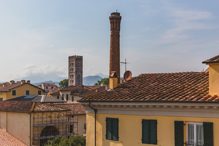 View of towers over buildings in Lucca, Tuscany, Italy Banco de Imagens