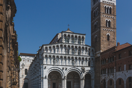 Front facade of St Martin Cathedral and tower, in the historic centre of Lucca, Tuscany, Italy