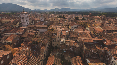 View of architecture and buildings of Lucca, Tuscany, Italy, with mountain landscape in the distance Standard-Bild - 122389570