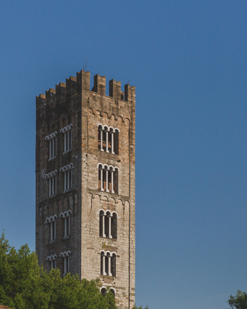 Tower of Basilica of San Frediano, a 12th-century Romanesque church, in the historic centre of Lucca, Tuscany, Italy Banco de Imagens