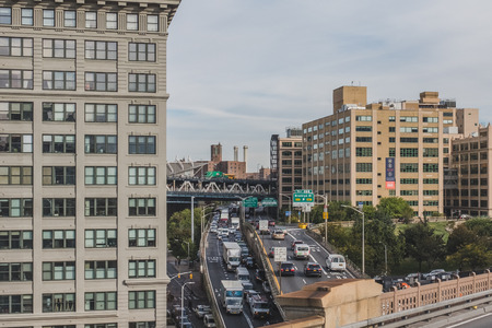 New York City, USA - Oct. 19, 2018: Cars traveling in the freeways of Brooklyn between buildings Standard-Bild - 122541742