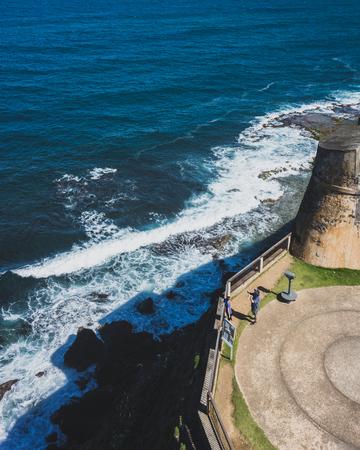 San Juan, Puerto Rico, USA - Jan. 2, 2018: tourists taking photos at San Cristobal fort, next to coastline, in old San Juan, Puerto Rico Standard-Bild - 122738360