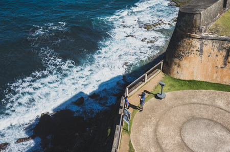 San Juan, Puerto Rico, USA - Jan. 2, 2018: tourists taking photos at San Cristobal fort, next to coastline, in old San Juan, Puerto Rico Standard-Bild - 122738361