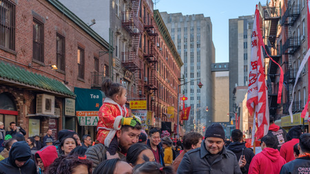 New York City, USA - Feb 16, 2019: Street crowded with people during a Chinese New Year Celebration event in Chinatown Standard-Bild - 123883666