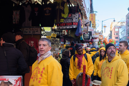 New York City, USA - Feb 16, 2019: A dragon dance group waiting to perform in the streets during a Chinese New Year Celebration event in Chinatown Standard-Bild - 123883678