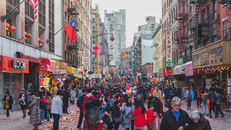 Manhattan, New York, USA - Feb. 5, 2019: Street crowded with people participating the Chinese New Year celebration event in Chinatown Standard-Bild - 123883682