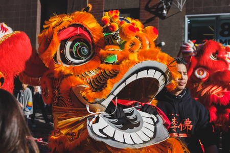Manhattan, New York, USA - Feb. 5, 2019: Lion dance performers during a Chinese New Year celebration event in Chinatown Editorial