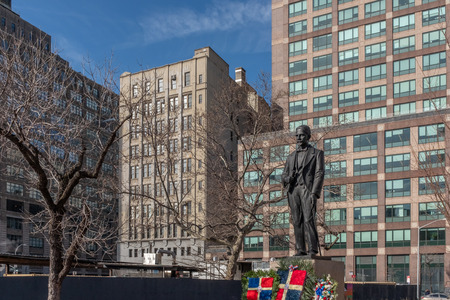 New York City, USA - Feb. 28, 2019: Statue of Juan Pablo Duarte, one of the founding fathers of the Dominican Republic, at Duarte Square, with Dominican flags and flowers Standard-Bild - 123883685