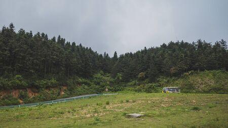 May 18, 2019 - Yichun,Jiangxi, China: Tourist shuttle traveling on road on top of Mingyue Mountain