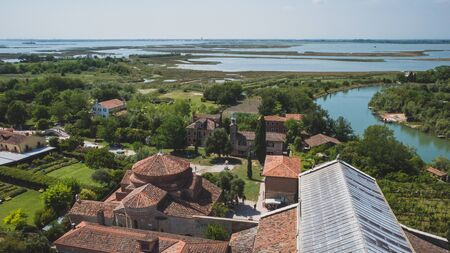 View of island of Torcello with churches and buildings, from bell tower of Cathedral of Santa Maria Assunta, in Torcello, Venice, Italy