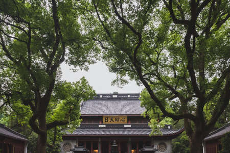 Hangzhou, China - 14 May 2019: main hall of the Yue Fei Memorial Temple complex under trees
