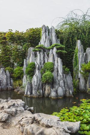 Giant rock in pond at Lingering Garden Scenic Area in Suzhou, Jiangsu, China