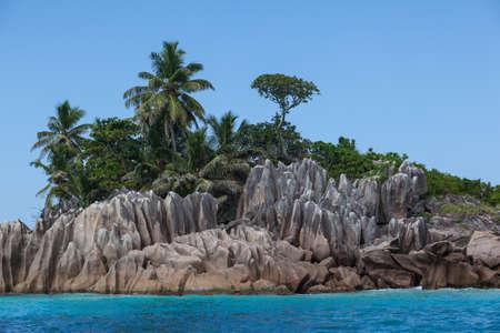 Granite boulders on the ocean shore Seychelles islands