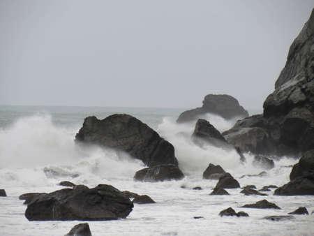 Tides Crashing on Rocky Beach photo