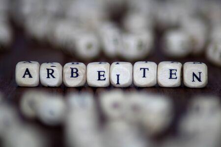 ARBEITEN word with blocks.job business leadership dice concept