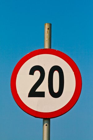 sky is the limit: Close-up of a speed limit traffic sign against the blue sky