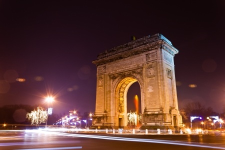 Arc De Triomphe in de nacht, Boekarest, Roemenië Stockfoto