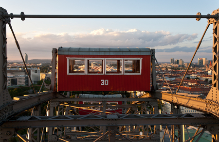 The big Viennese ferris wheel cabin up in the sky photo