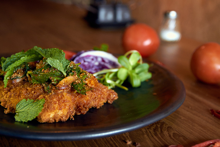isaan: Larb dolly. Isaan (Northeast of Thailand) style fried dolly fish with herbs and onions